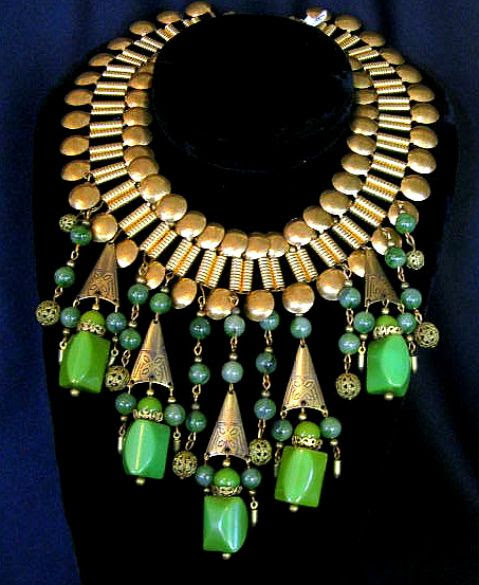 the-ephemeral-magpie:    A vintage Egyptian Revival inspired Bakelite bib necklace available through Unforgettable Vintage, circa 1940s.