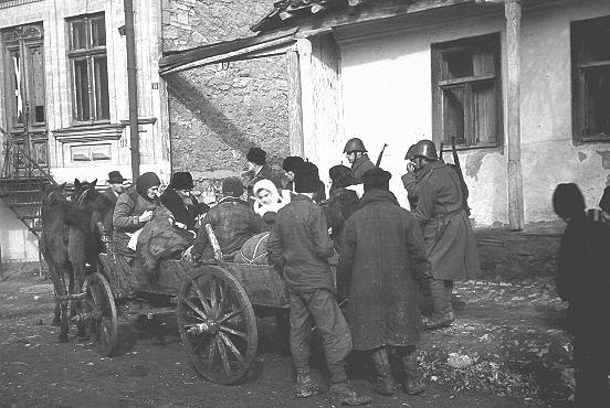 Romanian soldiers supervise the deportation of Jews from Kishinev. Kishinev, Bessarabia,  October 28, 1941.