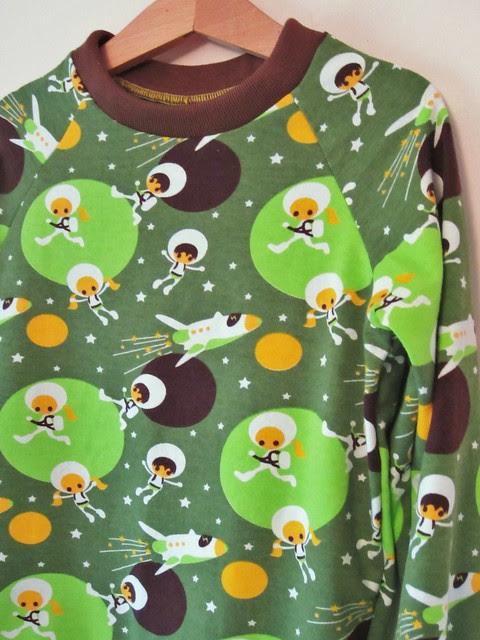 green astronaut top detail