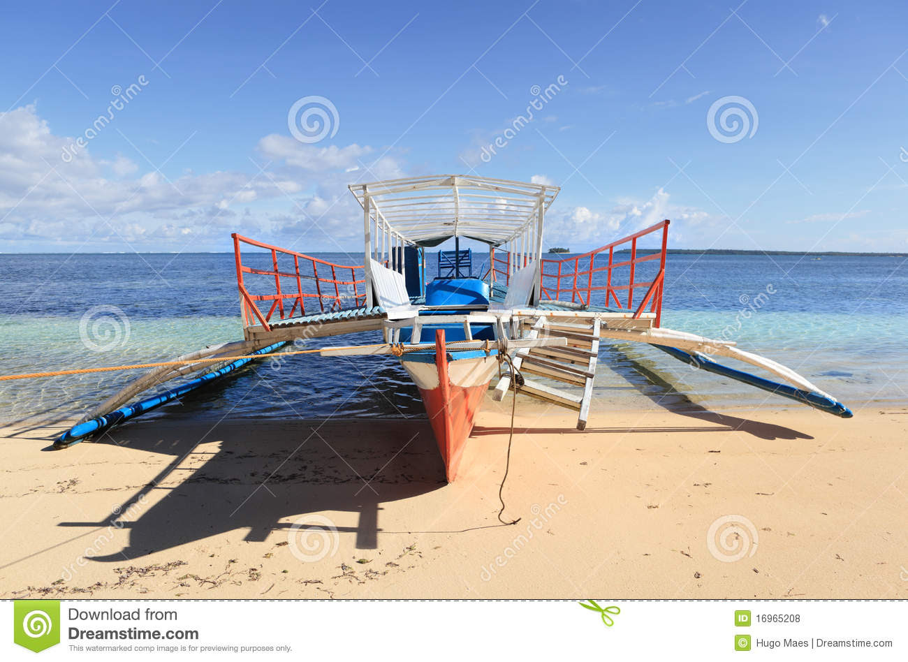 typical local bangka outrigger vessel or boat as used for passenger