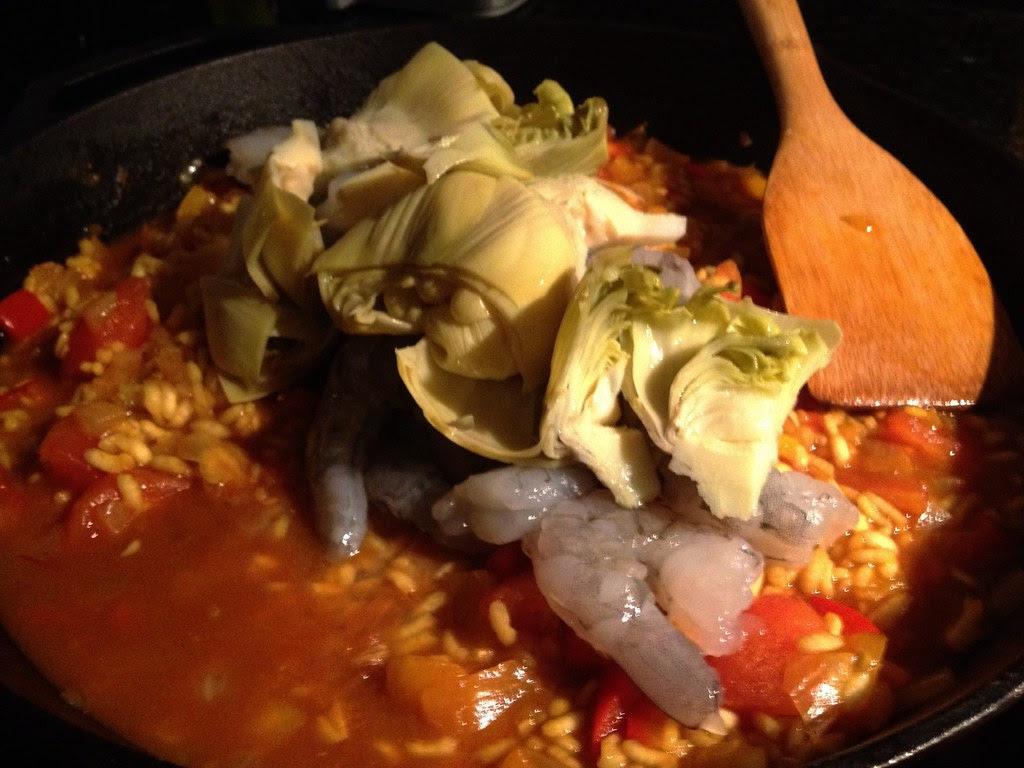 shrimp paella - adding the shrimp and artichokes