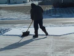 Jeffrey Shovels the Driveway