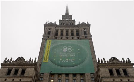Greenpeace activists fix a banner on the Palace of Culture and Science demanding protection of the Arctic region and the release of the so-called ''Arctic 30'' group during the 19th conference of the United Nations Framework Convention on Climate Change (COP19) in Warsaw November 21, 2013. (Credit: Reuters/Kacper Pempel) Click to enlarge.