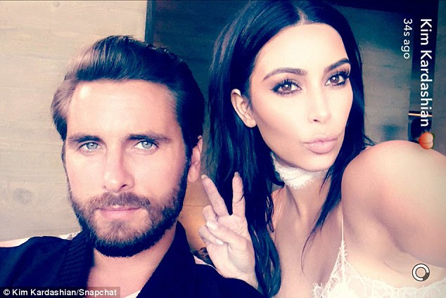 Close: Kim was the life and soul of the party and documented it on her Snapchat, and posing up a storm with birthday boy Scott
