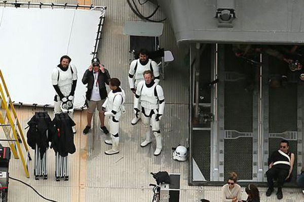 Background actors dressed as Imperial stormtroopers wait to film a scene for STAR WARS ANTHOLOGY: ROGUE ONE.