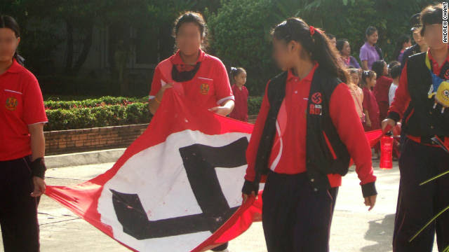 A giant Nazi flag is carried by students along a street in the northern Thai city.
