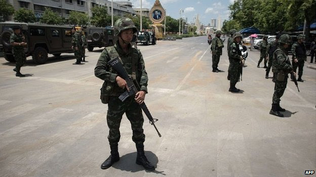 Thai soldiers stand guard in front of a small protest opposing the coup in Bangkok - 23 May 2014
