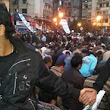 Images of solidarity as Christians join hands to protect Muslims as they pray during Cairo protests