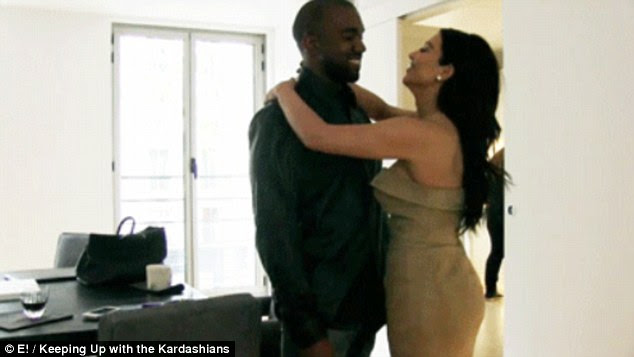 Kim hugs Kanye in an episode of Keeping Up With The Kardashians filmed at the apartment