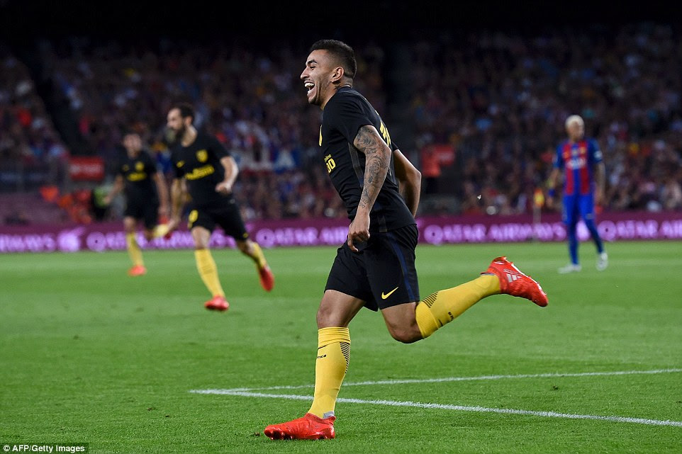 Atletico Madrid's Argentinian forward Angel Correa celebrates his goal which secured his team a point at the champions