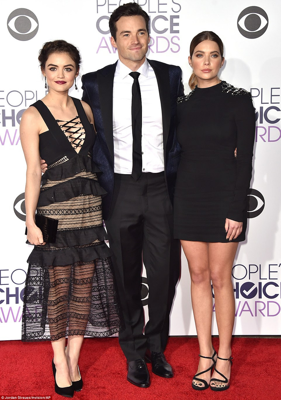 He's a lucky man: The show's hunk Ian Harding posed for photos with Lucy Hale and Ashley Benson