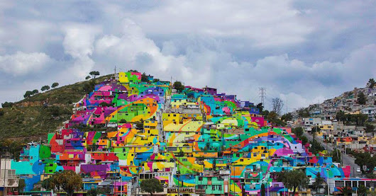 Street artists paint 209 houses to transform hillside into beautiful mural