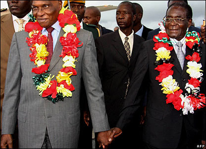 President Abdoulaye Wade of Senegal with President Robert Mugabe of Zimbabwe during a recent visit commemorating the 50th anniversary of the independence of Senegal. by Pan-African News Wire File Photos