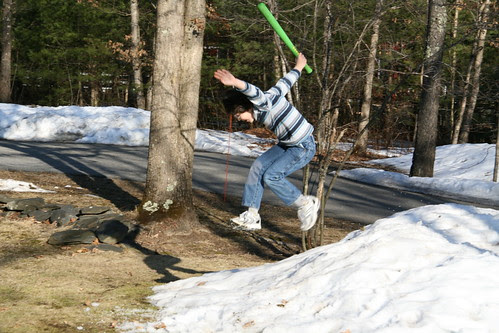 Adam jumps off a snowbank