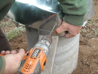 Drilling a Rivet Hole in the Concrete Pier Homemade Termite Shield