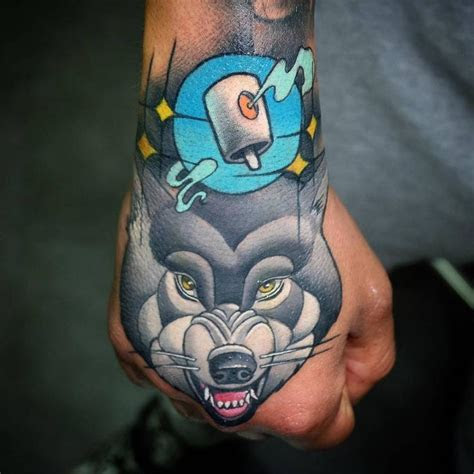 school wolf tattoo hand animal tattoos