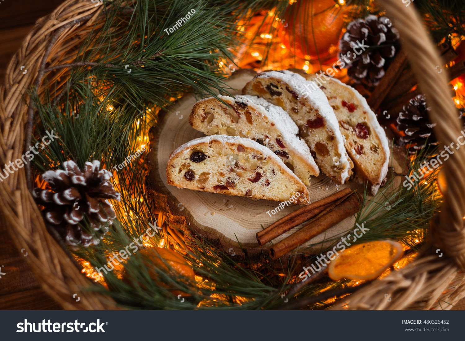 http://www.shutterstock.com/pic-480326452/stock-photo-slices-of-stollen-on-festive-rustic-wooden-background-with-cchristmas-light-bokeh-shallow-focus.html