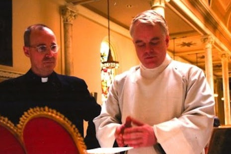 <p>Fr James Martin SJ, left, with Philip Seymour Hoffman during the filming of Doubt (photo by Andy Schwartz)</p>