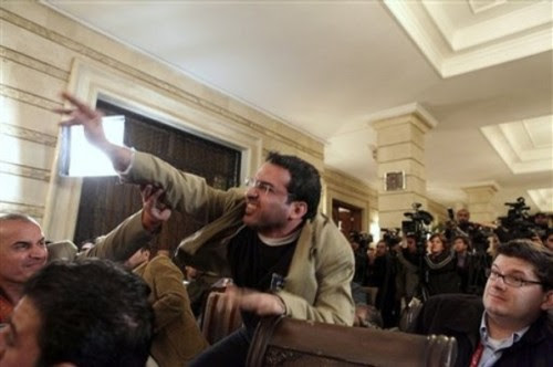 An Iraqi man throws a shoe at President George W. Bush during a new conference with Iraq Prime Minister Nouri al-Maliki on Sunday, Dec. 14, 2008, in Baghdad. A man threw two shoes at Bush, one after another, during the news conference. Bush ducked both throws, and neither man was hit. (AP Photo/Evan