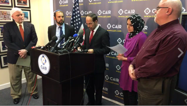 CAIR Executive Director Nihad Awad speaks at a press conference in Washington, D.C., Jan. 25, 2017. From the left are CAIR spokesman Ibrahim Hooper and Rabbi Joseph Berman. From the right are Steven Martin, communications director for the National Council of Churches and Rabiah Ahmed of the Muslim Public Affairs Council.