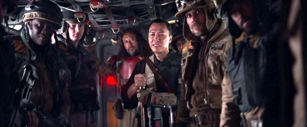 Chirrut Îmwe (Donnie Yen), Baze Malbus (Wen Jiang) and their fellow Rebels react to a speech made by Jyn Erso (off-screen) in ROGUE ONE: A STAR WARS STORY.