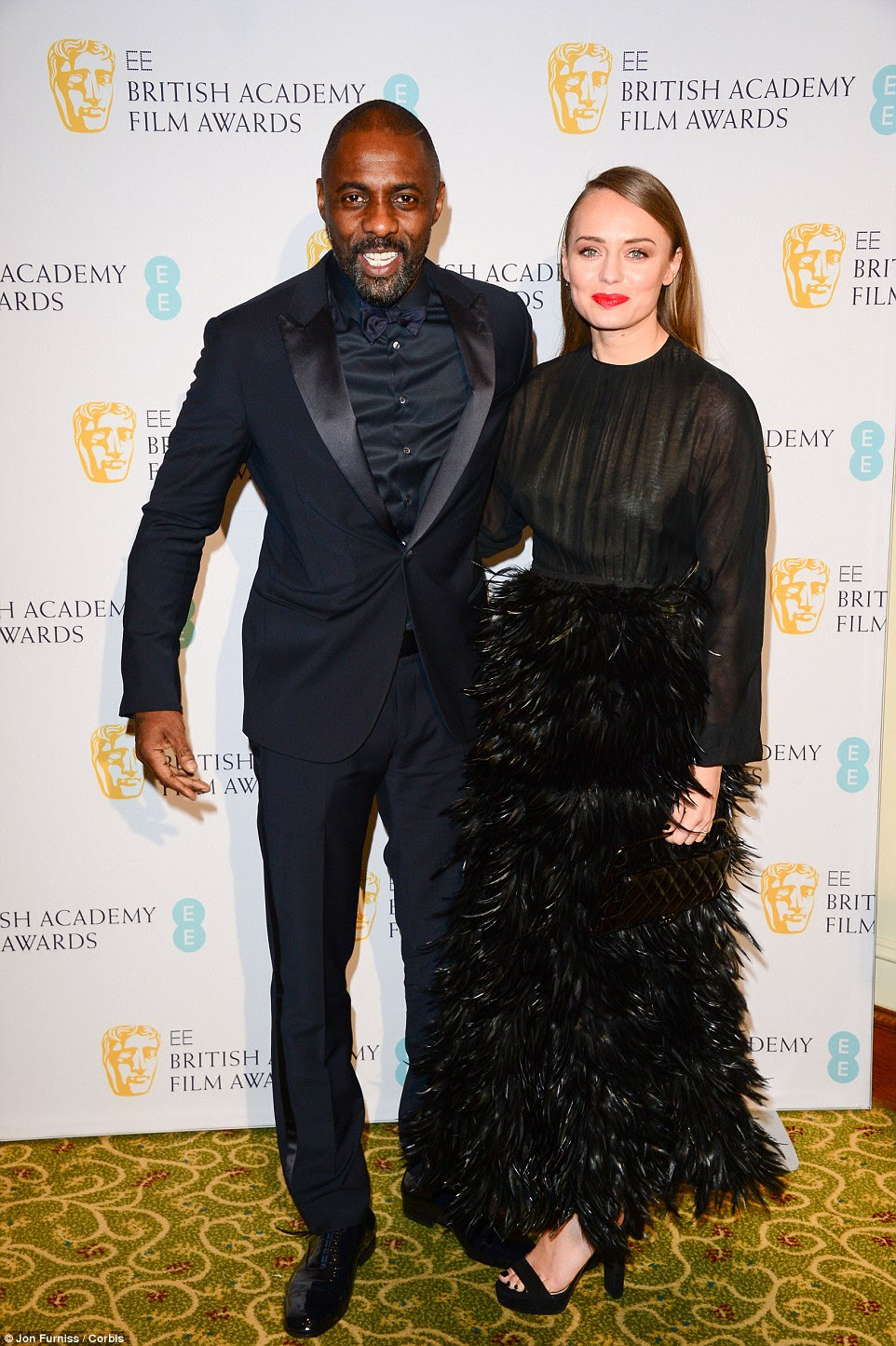 Rubbing shoulders with the stars: Laura looked overjoyed to pose with superstar Idris Elba