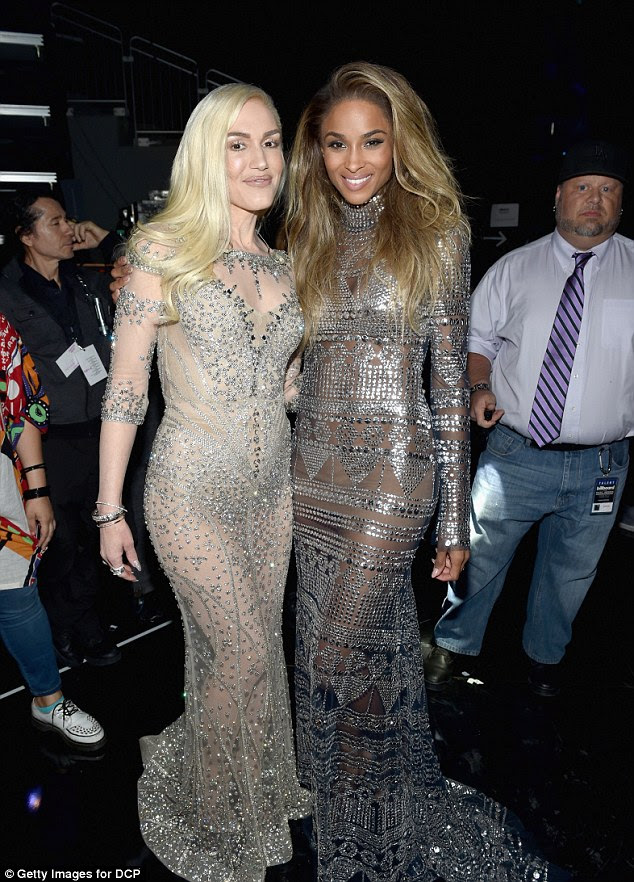 Shimmering stars: Ciara cosied up to Gwen Stefani backstage