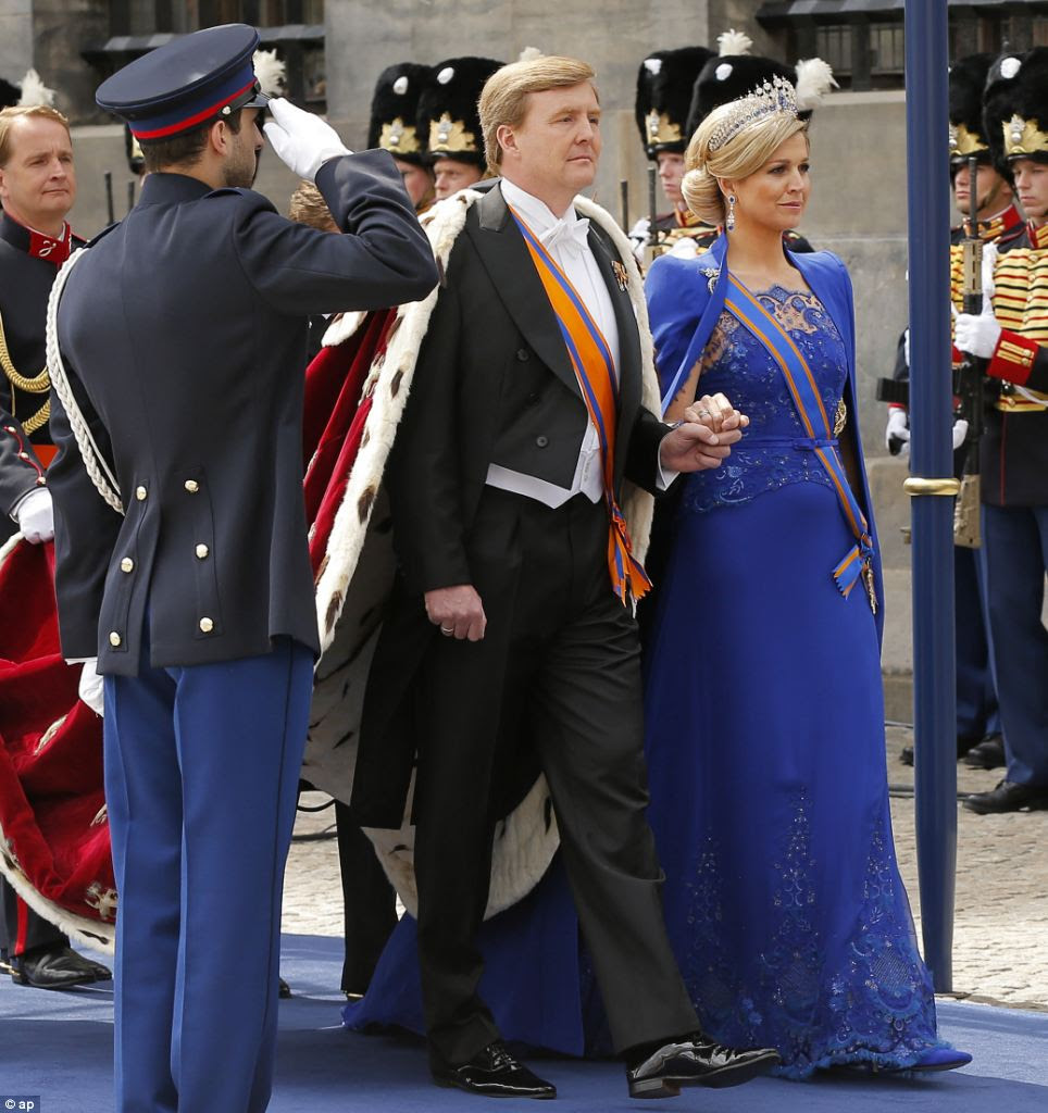Blue vision: Dutch King Willem-Alexander and his wife Queen Maxima arrive at the Nieuwe Kerk or New Church in Amsterdam for his inauguration