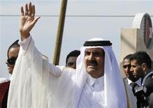 The Emir of Qatar Sheikh Hamad bin Khalifa al-Thani waves to the crowd upon his arrival at a cornerstone laying ceremony for a Qatari funded rehabilitation center in Gaza City October 23, 2012. REUTERS/Hatem Moussa/Pool