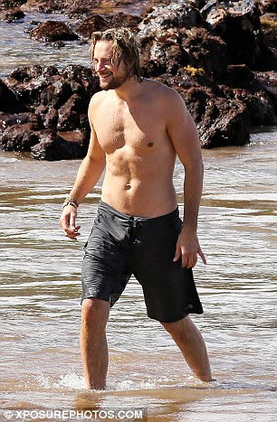 That was refreshing: The Montreal-born hunk was smiling as he sprinted out of the ocean to shore