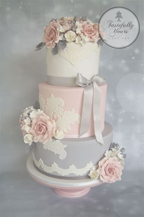 Wedding cake with lace in pink, white and grey with