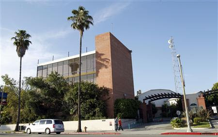 People walk past the building where television station KCET used to be housed in Los Angeles, California