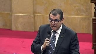 El conseller d'Interior, Jordi Jané, fent l'anunci al Parlament