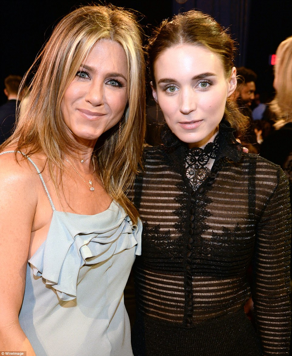 Keeping a low profile: Although Rooney Mara (R) didn't walk the red carpet, she posed for a photo with Jennifer Aniston once inside