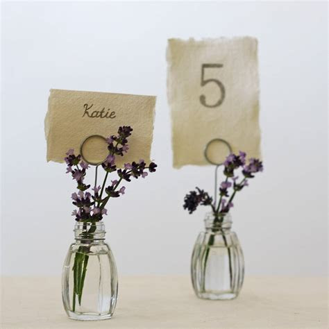 set of four bud vase name card holders by the wedding of