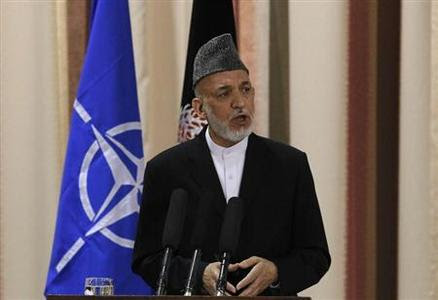 Afghan President Hamid Karzai speaks during a joint news conference with NATO Secretary General Anders Fogh Rasmussen following a security handover ceremony at a military academy outside Kabul June 18, 2013. REUTERS-Omar Sobhani