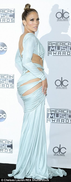 Host with the most: J.Lo's final look was held together with sexy straps across her chest and midriff