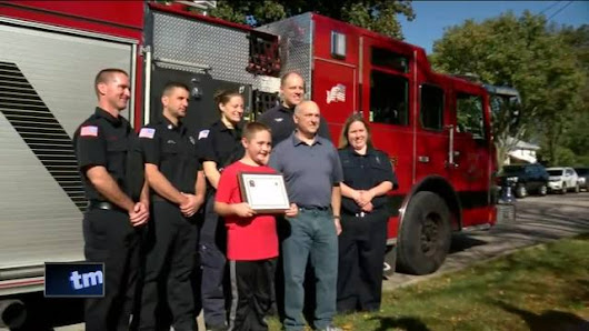 10-year-old boy who saved father honored