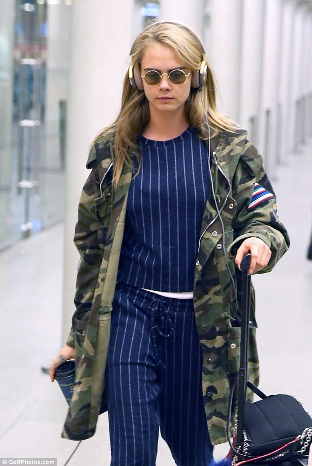 No days off: Delevingne still managed to look like she was ready for a photo-shoot in her quirky outfit
