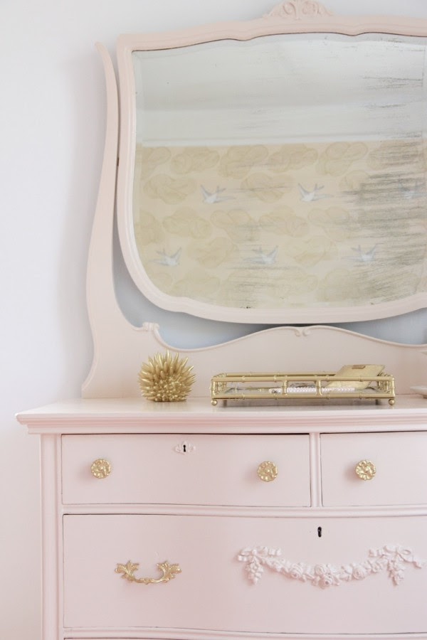 Phoebe's dresser is painted Benjmain Moore Raleigh Peach in Semi-Gloss Advance paint.