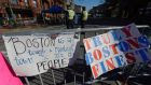 Signs at a makeshift memorial  for victims of the Boston Marathon bombings, near the marathon finish line. Photograph: Kevork Djansezian/Getty Images
