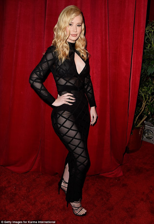 Racy on the red carpet: Opting for a modern update on the classic black ballgown, Iggy slipped her famous curves into a skin-tight dress which left very little to the imagination