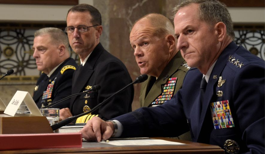 """From left: Army Gen. Mark Milley, Navy Adm. John Richardson, Marine Corps Gen. Robert Neller and Air Force Gen. David Goldfein acknowledged to the Senate Arms Services Committee that they had not discussed the readiness crisis with their commander in chief. Donald Trump said generals under President Obama have been """"reduced to rubble."""" (Associated Press)"""