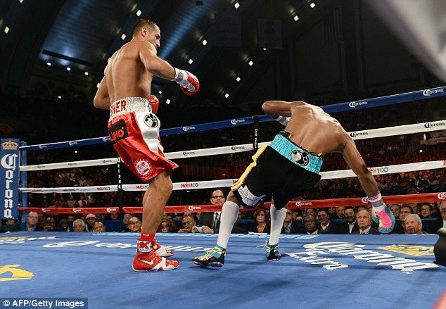 Sergey Kovalev knocks down Hopkins in the first round on his way to a comprehensive victory