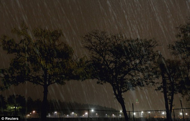 Hail: The Empire State Building is just visible as the storm batters Hoboken, New Jersey