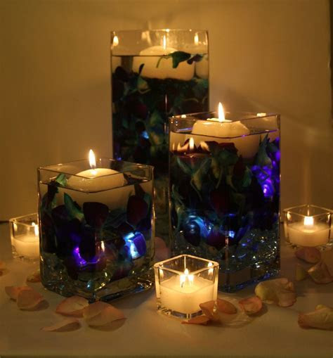 Blue dendrobium orchids with floating candles. Floating