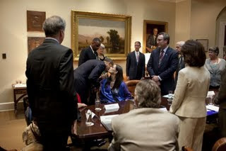 Obama circulating the room, back of Mike pictured