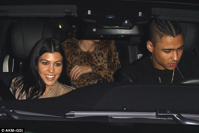 That smile says a million words: The E! princess beamed as she left with the hunky son of the NY rapper