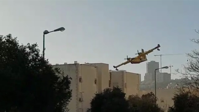 Foreign firefighting plane over Haifa