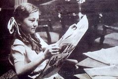 Princess Faeka reading a newspaper